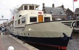 Boot huren Amsterdam. Woonboot Orca